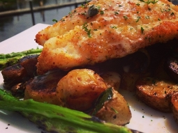 Parmesan crusted grouper, over a fingerling potato hash served with a side of grilled asparagus; finished with a lemon caper sauce. #fishhousepensacola #yum #lunchtime