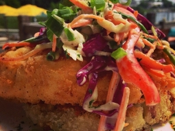 Fried hog snapper, topped with a jalapeño slaw, and served over an andouille, onion, and poblano potato cake. #fishhousepensacola #lunch #yum #foodporn