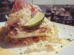 #grilledmahi topped with a pineapple and guava slaw, served over #Caribbean rice pilaf. #lunch #yum #fishhousepensacola #downtownpensacola #seafood