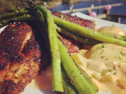 Blackened snapper over three cheese ravioli tossed in a lobster fennel cream sauce, served with a side of grilled asparagus. #fishhousepensacola #foodporn #seafood #snapper #yum