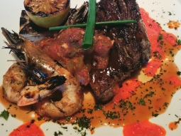 Long braised sirloin strap and grilled prawns with a marble potato cake, creole tomato jam, and red pepper coulis. #fishhousepensacola #yum #foodporn #surfnturf #creole #downtownpensacola