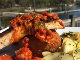 It's lunch time! Today's special is lightly blackened amber jack served with a fried polenta cake and lemon pepper squash medley, topped with red pepper and artichoke marinara.  #fishhousepensacola #downtownpensacola #upsideofflorida
