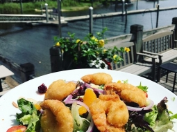 It's lunch time! Today's special: Ginger fried shrimp over mixed greens with tomato, cucumber, onion, craisins, mandarin oranges, toasted almonds, and finished with miso vinaigrette